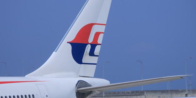 Osaka, Japan - 20 June, 2014: Malaysian airlines airplane parks at Kansai Airport in Osaka Japan.