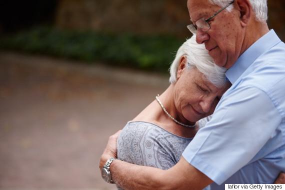 hugging senior woman sad