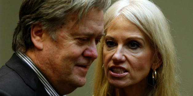 U.S. President Donald Trump's chief strategist Steve Bannon (L) and senior aide Kellyanne Conway speak at meeting hosted by Trump with cyber security experts in the Roosevelt Room of the White House in Washington January 31, 2017.  REUTERS/Kevin Lamarque