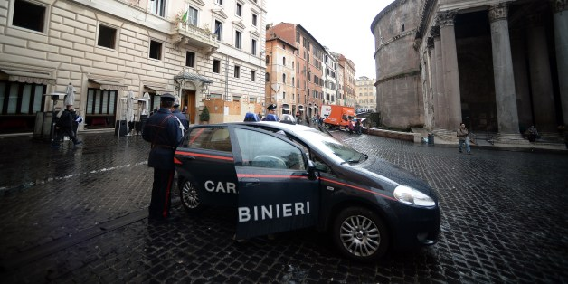 A Carabiniere military police car is parked in front of 'Ciuccula' bar, one of the around 20 restaurants and bars seized by police in Rome's historic center on January 22, 2014. Italian police swooped to arrest 90 people in a massive round up against the Contini clan of the Neapolitan Camorra Mafia believed to be heavily involved in laundering illicit earnings via apparently normal businesses and other investments, seizing 250 million euros worth of assets. AFP PHOTO / Filippo MONTEFORTE        (Photo credit should read FILIPPO MONTEFORTE/AFP/Getty Images)