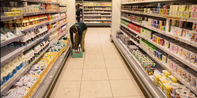 An employe restocks the dairy products section at a supermarket in Nairobi, Kenya May 8, 2017. Picture taken May 8, 2017. REUTERS/Baz Ratner
