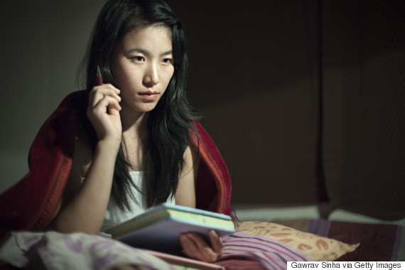 teen studying at night