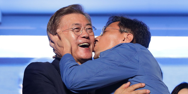 SEOUL, SOUTH KOREA - MAY 09:  South Chungcheong governor An Hee-jung kisses South Korean President-elect Moon Jae-in, of the Democratic Party of Korea, at Gwanghwamun Square on May 9, 2017 in Seoul, South Korea. Moon Jae-in declared victory in South Korea's presidential election, which was called seven months early after former President Park Geun-hye was impeached for her involvement in a corruption scandal.  (Photo by Chung Sung-Jun/Getty Images)
