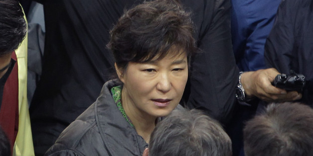 JINDO-GUN, SOUTH KOREA - APRIL 17:  South Korean President Park Geun-Hye talks with relatives of missing passengers of a sunken ferry at Jindo gymnasium on April 17, 2014 in Jindo-gun, South Korea. Six are dead, and 290 are missing as reported. The ferry identified as the Sewol was carrying about 470 passengers, including the students and teachers, traveling to Jeju Island.  (Photo by Chung Sung-Jun/Getty Images)