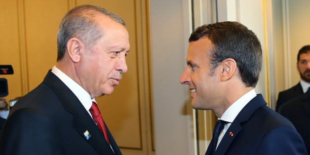 BRUSSELS, BELGIUM - MAY 25:  Turkish President Recep Tayyip Erdogan (L) and French President Emmanuel Macron (R) shake hands during their meeting in Brussels, Belgium on May 25, 2017.