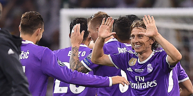 Real Madrid's Croatian midfielder Luka Modric (R) celebrates after winning the UEFA Champions League final football match between Juventus and Real Madrid at The Principality Stadium in Cardiff, south Wales, on June 3, 2017. / AFP PHOTO / Filippo MONTEFORTE        (Photo credit should read FILIPPO MONTEFORTE/AFP/Getty Images)