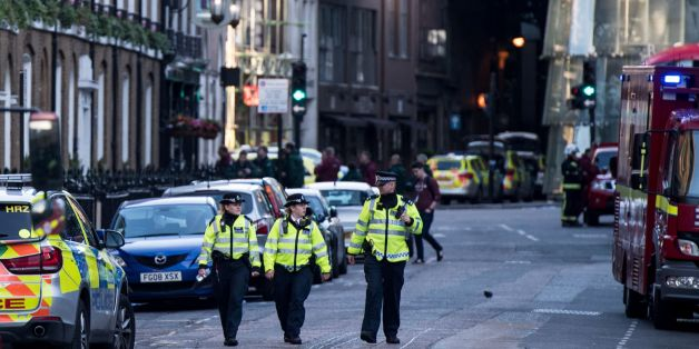 Police officers and emergency response vehicles are seen on the street outside Borough Market on June 04, 2017 the morning after a terror attack on London Bridge and the Borough area in London. Six people have been reportedly killed and three terror suspects shot dead by police following the attack on the evening on June 03, 2017. / AFP PHOTO / CHRIS J RATCLIFFE        (Photo credit should read CHRIS J RATCLIFFE/AFP/Getty Images)