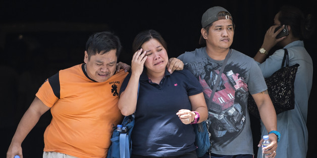 Relatives of a victim cry outside the Resorts World Hotel in Manila on June 2, 2017. A masked gunman set fire to a gaming room at a casino in the Philippine capital on June 1, igniting a toxic blaze that killed 36 people, authorities said, but they insisted it was not a terrorist attack. / AFP PHOTO / RODY        (Photo credit should read RODY/AFP/Getty Images)
