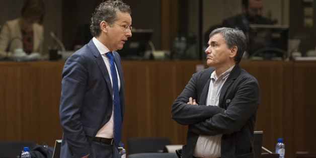 Jeroen Dijsselbloem, Dutch finance minister and head of the group of euro-area finance ministers, left, speaks with Euclid Tsakalotos, Greece's finance minister, ahead of an Ecofin meeting of European Union (EU) finance ministers in Brussels, Belgium, on Tuesday, Dec. 6, 2016. The euro-area economy expanded at the fastest pace this year in November as companies took on workers and kept political concerns at bay. Photographer: Jasper Juinen/Bloomberg via Getty Images