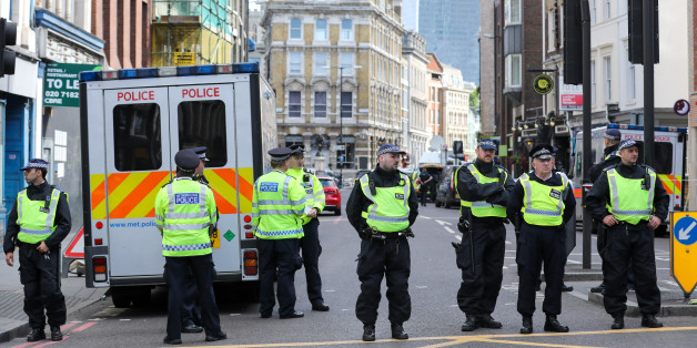 Police officers create a cordon line as they stand in the area near a terror attack in London, U.K., on Sunday, June 4, 2017.A van swerved into Saturday-night crowds on London Bridge, before three men got out and went on a stabbing rampage through nearby bars.Photographer: Luke MacGregor/Bloomberg via Getty Images
