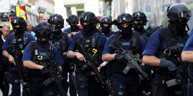 Armed police officers walk near Borough Market after an attack left 7 people dead and dozens injured in London, Britain, June 4, 2017. REUTERS/Peter Nicholls