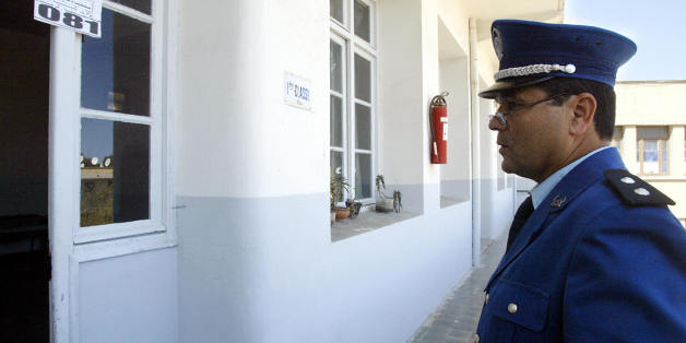 ALGIERS, ALGERIA:  An Algerian policeman stands guard while a room of an Algiers casbah school is prepared for the elections 07 April 2004.  On the eve of what is shaping up as the most democratic presidential election ever to be held in Algeria, the press and most of the candidates in the polls today accused the incumbent Abdelaziz Bouteflika of plotting to steal the vote. The tabloid press, quoting 'very reliable sources,' described a Machiavellian series of events in which state television wo