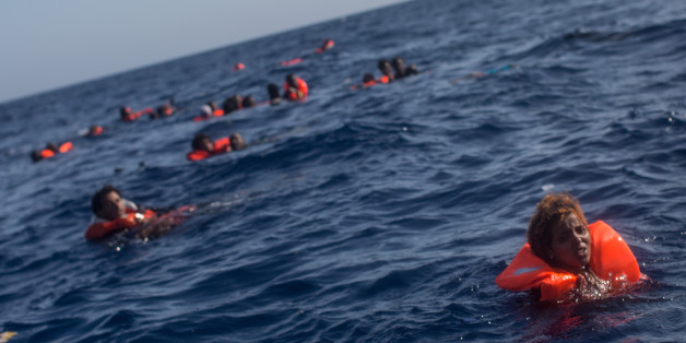 LAMPEDUSA, ITALY - MAY 24:  Refugees and migrants are seen swimming and yelling for assistance from crew members from the Migrant Offshore Aid Station (MOAS) 'Phoenix' vessel after a wooden boat bound for Italy carrying more than 500 people capsized on May 24, 2017 off Lampedusa, Italy. Numbers of refugees and migrants attempting the dangerous central Mediterranean crossing from Libya to Italy has risen since the same time last year with more than 43,000 people recorded so far in 2017. In an attempt to slow the flow of migrants Italy recently signed a deal with Libya, Chad and Niger outlining a plan to increase border controls and add new reception centers in the African nations, which are key transit points for migrants heading to Italy. MOAS is a Malta based NGO dedicated to providing professional search-and-rescue assistance to refugees and migrants in distress at sea. Since the start of the year MOAS have rescued and assisted 3572 people and are currently patrolling and running rescue operations in international waters off the coast of Libya.  (Photo by Chris McGrath/Getty Images)