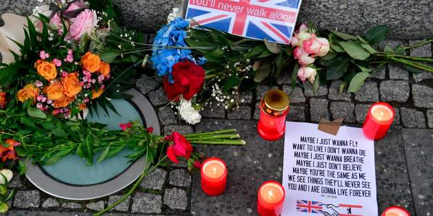 Flowers and candles as tribute to the victims of the June 3 terror attack in London are pictured on June 4, 2017 at the British embassy in Berlin. / AFP PHOTO / John MACDOUGALL        (Photo credit should read JOHN MACDOUGALL/AFP/Getty Images)
