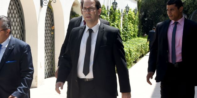 Tunisia's premier-designate Youssef Chahed (C) arrives to give a press conference to present his proposed new unity government list after he submitted it to the president on August 20, 2016 in Carthage, near the capital Tunis.  Chahed, a 40-year-old former local affairs minister and member of the Nidaa Tounes party, had been given 30 days to form a cabinet. If his cabinet wins the backing of parliament, Chahed will become the North African country's youngest premier since independence from France in 1956.  / AFP / FETHI BELAID        (Photo credit should read FETHI BELAID/AFP/Getty Images)