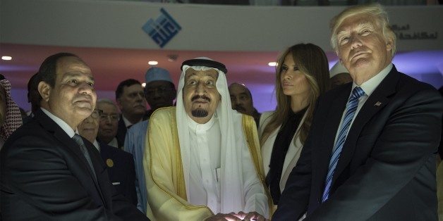 RIYADH, SAUDI ARABIA - MAY 21: (----EDITORIAL USE ONLY  MANDATORY CREDIT - 'BANDAR ALGALOUD / SAUDI ROYAL COUNCIL / HANDOUT' - NO MARKETING NO ADVERTISING CAMPAIGNS - DISTRIBUTED AS A SERVICE TO CLIENTS----)US President Donald Trump, US First lady Melania Trump (2nd R), Saudi Arabia's King Salman bin Abdulaziz al-Saud (2nd L) and Egyptian President Abdel Fattah el-Sisi (L) put their hands on an illuminated globe  during the inauguration ceremony of the Global Center for Combating Extremist Ideol