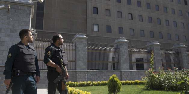 TEHRAN, IRAN - JUNE 7: Police officers stand outside Iran's parliament building following an attack by several gunmen on June 7, 2017 in Tehran, Iran. At least 12 people were killed and dozens more wounded during simultaneous gun and suicide bomb attacks in Iran's capital.  A suicide bomber targeted the shrine of Ayatollah Ruhollah Khomeini while several gunmen launched an attack on the parliament building, which is now reportedly over following hours of audible gun-fire. (Photo by Majid Saeedi/