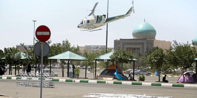 A picture taken on June 7, 2017, shows a police helicopter flying around outside the mausoleum of Ayatollah Ruhollah Khomeini in Tehran.