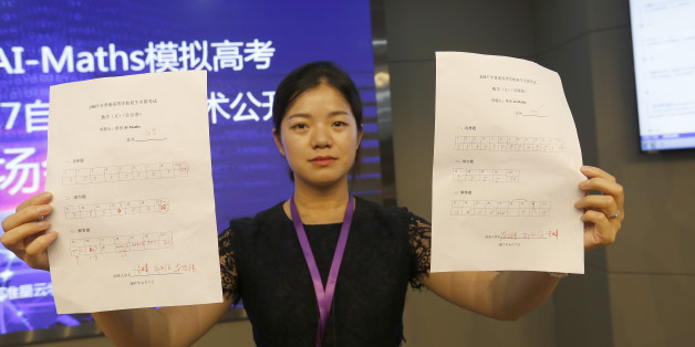 CHENGDU, CHINA - JUNE 07:  A staff member shows the scores of math tests taken by the robot AI-Maths on June 7, 2017 in Chengdu, Sichuan Province of China. Robot AI-Maths, developed by a tech firm in Chengdu, sit match tests of 2017 national college entrance exam (aka Gaokao) on Wednesday evening in Chengdu. The AI-Maths finished the math test for Beijing liberal arts students in 22 minutes with a score of 105, and the national exam paper II's math test for liberal arts students in 10 minutes wi