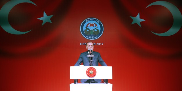 KAYSERI, TURKEY - JUNE 8: Turkish President Recep Tayyip Erdogan delivers a speech during his Iftar (fast breaking) dinner with families of Martyrs and soldiers at the 1st Commando Brigade in Kayseri, Turkey on June 8, 2017. (Photo by Kayhan Ozer/Anadolu Agency/Getty Images)