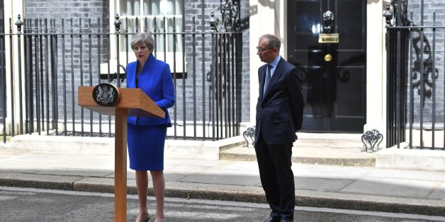 Britain's Prime Minister and leader of the Conservative Party Theresa May, (L), accompanied by her husband Philip, delivers a statement outside 10 Downing Street in central London on June 9, 2017 as results from a snap general election show the Conservatives have lost their majority. British Prime Minister Theresa May will on Friday seek to form a new government, resisting pressure to resign after losing her parliamentary majority ahead of crucial Brexit talks. May is set to meet the head of state Queen Elizabeth II and ask for permission to form a new government, according to her Downing Street office. / AFP PHOTO / Ben STANSALL        (Photo credit should read BEN STANSALL/AFP/Getty Images)