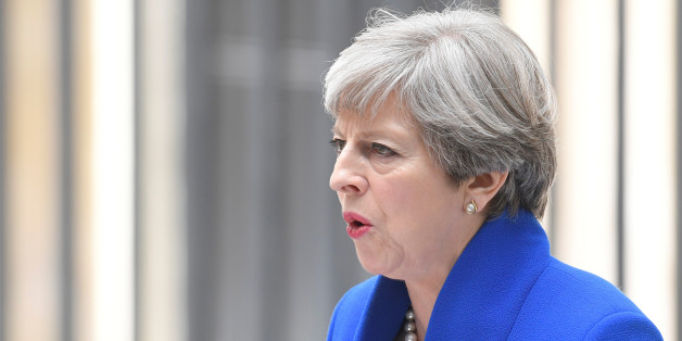 Britain's Prime Minister Theresa May makes a statement in Downing Street after traveling to Buckingham Palace to ask the Queen's permission to form a minority government, in London, June 9, 2017. REUTERS/Toby Melville