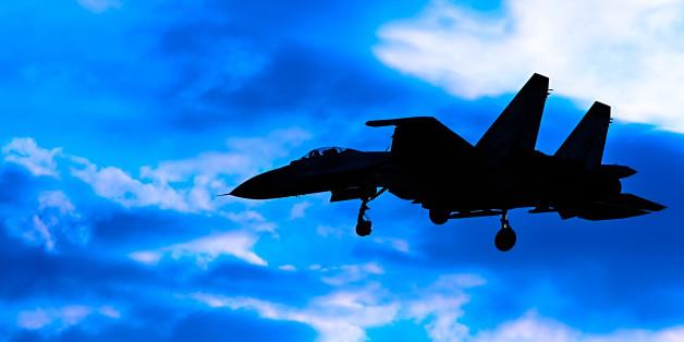 Contour aircraft Su-27 against the sky