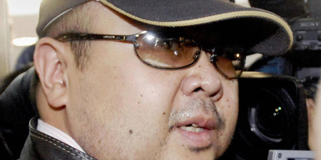 Beijing, CHINA: A man believed to be North Korean leader Kim Jong-Il's eldest son, Kim Jong-Nam, is surrounded by journalists upon his arrival at Beijing's capital airport, 11 February 2007. Wearing a cap, sunglasses and jeans, the man who Japanese television crew described as Kim Jong-Nam arrived at Beijing's airport from Macau in the afternoon, as six-nation talks on ending North Korea's nuclear weapons programme were underway in the Chinese capital.  Kim Jong-Nam, 35, was recently reported to