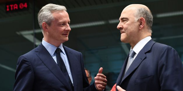 France's new Economy Minister Bruno Le Maire (L) speaks to European Commissioner for Economic and Financial Affairs, Taxation and Customs Pierre Moscovici during a Eurogroup finance ministers meeting on May 22, 2017 at the European Council in Brussels. / AFP PHOTO / EMMANUEL DUNAND        (Photo credit should read EMMANUEL DUNAND/AFP/Getty Images)
