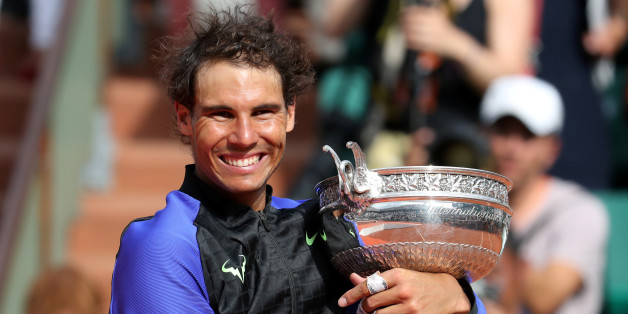 Tennis - French Open - Roland Garros, Paris, France - June 11, 2017   Spain's Rafael Nadal celebrates with the trophy after winning the final against Switzerland's Stan Wawrinka   Reuters / Pascal Rossignol