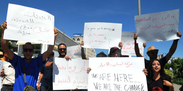 Tunisian protesters hold placards during a demonstration for the right to eat and smoke in public during the Muslim dawn-to-dusk fasting month of Ramadan, on June 11, 2017, in Tunis. A court in northern Tunisia handed one-month jail terms in the beginning of June to four men for eating in public during the Ramadan fast. / AFP PHOTO / Sofienne HAMDAOUI        (Photo credit should read SOFIENNE HAMDAOUI/AFP/Getty Images)