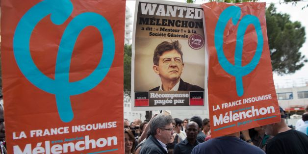 Leader of the political movement 'La France Insoumise', former French presidential candidate and current candidate in Marseille for France's upcoming legislative elections, Jean-Luc Melenchon (C), speaks with people during a campaign visit to the Cite Felix Pyat in Marseille, southeastern France, on June 3, 2017. The two-round parliamentary elections will take place on June 11 and June 18. / AFP PHOTO / BERTRAND LANGLOIS        (Photo credit should read BERTRAND LANGLOIS/AFP/Getty Images)