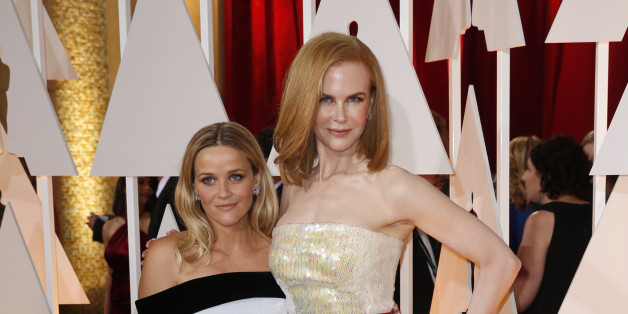 "Reese Witherspoon, best actress nominee for her role in ""Wild,"" poses with actress Nicole Kidman (R) at the 87th Academy Awards in Hollywood, California February 22, 2015.   REUTERS/Lucas Jackson (UNITED STATES TAGS:ENTERTAINMENT) (OSCARS-ARRIVALS)"