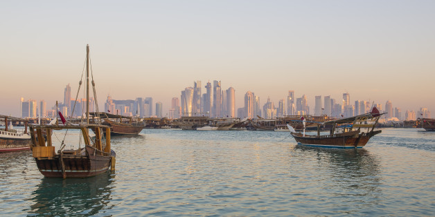 Traditional boats ( Dhows ) with background of Doha skyline , Qatar
