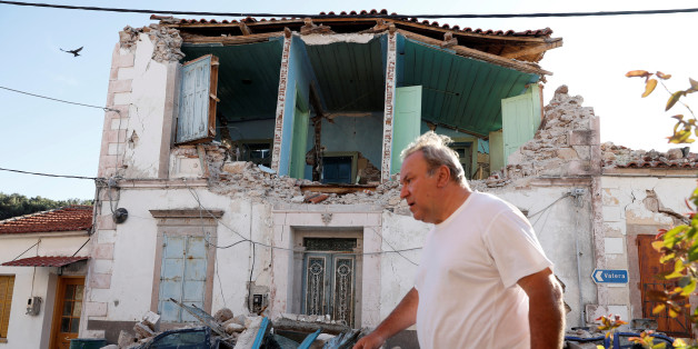 A man walks past a damaged building at the village of Vrissa on the Greek island of Lesbos, Greece, after a strong earthquake shook the eastern Aegean, June 12, 2017. REUTERS/Giorgos Moutafis