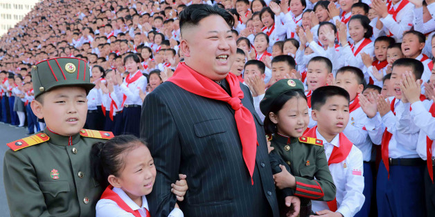 This picture taken on June 6, 2017 and released from North Korea's official Korean Central News Agency (KCNA) on June 9 shows North Korean leader Kim Jong-Un (C) at a photo session with the participants in the 8th Congress of the Korean Children's Union (KCU) in Pyongyang. / AFP PHOTO / KCNA VIA KNS / STR        (Photo credit should read STR/AFP/Getty Images)