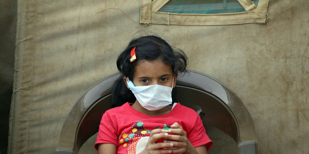 A Yemeni child suspected of being infected with cholera sits outside a makeshift hospital in Sanaa on June 5, 2017. Yemen is descending into total collapse, its people facing war, famine and a deadly outbreak of cholera, as the world watches, the UN aid chief said. / AFP PHOTO        (Photo credit should read /AFP/Getty Images)