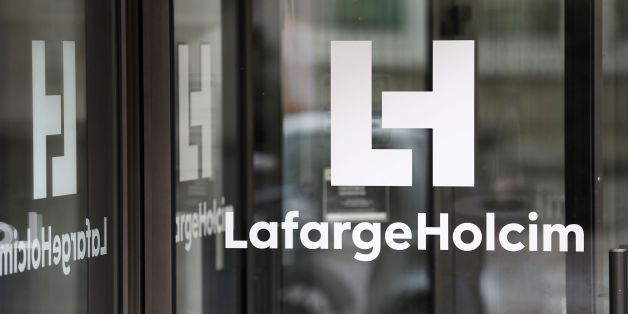 A picture taken on March 9, 2017, in Paris, shows a logo at an entrance of the French headquarters of LafargeHolcim, a group created in 2015 by the merger of French cement manufacturer Lafarge and its Swiss counterpart Holcim.French-Swiss group LafargeHolcim is ready to sell its cement to build US President Donald Trump's controversial border wall, the company's CEO said in an interview. The wall Trump promised to erect along the US-Mexico border, valued at tens of billions of dollars, is at the