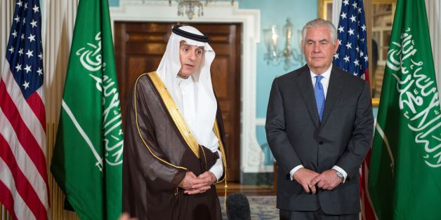 US Secretary of State Rex Tillerson listens as Saudi Foreign Minister Adel al-Jubeir(L) delivers brief remarks to the media on June 13, 2017, shortly before their private meeting at the US Department of State in Washington, DC. / AFP PHOTO / PAUL J. RICHARDS        (Photo credit should read PAUL J. RICHARDS/AFP/Getty Images)