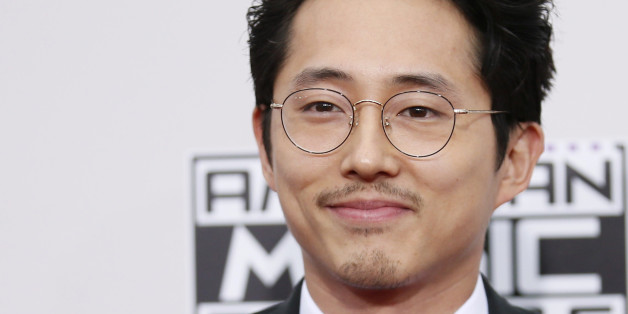 Actor Steven Yeun arrives at the 2016 American Music Awards in Los Angeles, California, U.S., November 20, 2016. REUTERS/Danny Moloshok