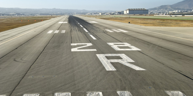 Landing runway at an airport, seen from the cockpit.