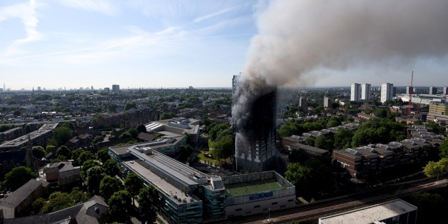 LONDON, ENGLAND - JUNE 14: Smoke rises from the building after a huge fire engulfed the 24 storey residential Grenfell Tower block in Latimer Road, West London in the early hours of this morning on June 14, 2017 in London, England. The Mayor of London, Sadiq Khan, has declared the fire a major incident as more than 200 firefighters are still tackling the blaze while at least 50 people are receiving hospital treatment (Photo by Kate Green/Anadolu Agency/Getty Images)