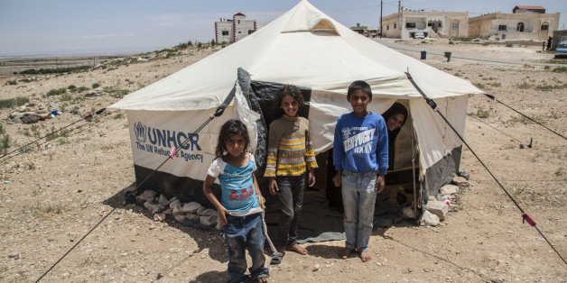 Syrian refugees are seen at the Zaatari  refugee camp, on the Jordanian border on 31 May 2017. It's the second refugee camp in the world . The field of Zaatari grows and spreads in the middle of nowhere. Of temporary solution to being the second largest refugee camp in the world and the fourth largest city in Jordan. Besieged by concertinas and guarded by the Jordanian army, the settlement currently accommodates 85,000 Syrian refugees, half of them children.  (Photo by Alvaro Fuente/NurPhoto via Getty Images)