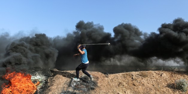 GAZA CITY, GAZA - JUNE 09 : A Palestinian protester with a slingshot clashes with the Israeli security forces during a protest against the Israeli blockade at Israeli border in eastern part of Jabalia Refugee Camp in Gaza City, Gaza on June 09, 2017. (Photo by Mustafa Hassona/Anadolu Agency/Getty Images)
