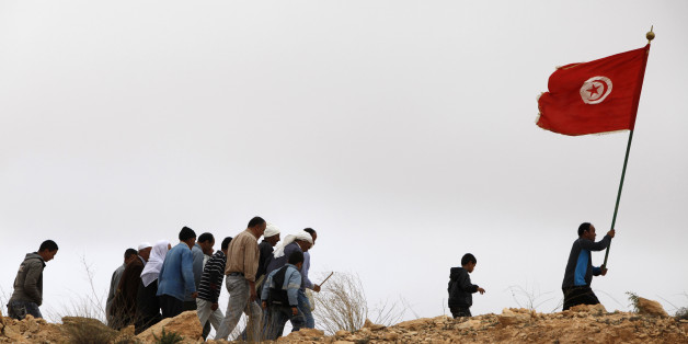 Group of Tunisian muslims walking up a hill (Photo by: Godong/Universal Images Group via Getty Images)
