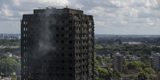 LONDON, ENGLAND - JUNE 15:  Debris hangs from the blackened exterior of Grenfell Tower on June 15, 2017 in London, England. At least 17 people have been confirmed dead and dozens missing, after the 24 storey residential Grenfell Tower block in Latimer Road was engulfed in flames in the early hours of June 14. The number of fatalities are expected to rise.  (Photo by Dan Kitwood/Getty Images)
