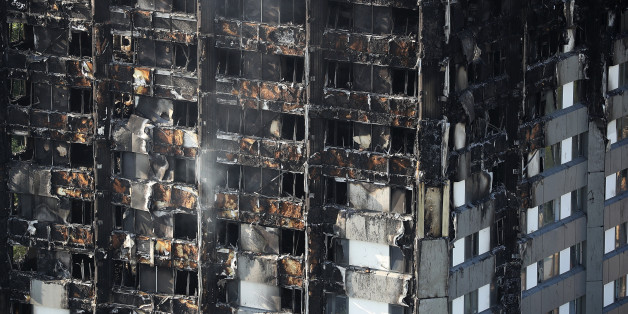 LONDON, ENGLAND - JUNE 15:  Grenfall tower continues to smoulder on June 15, 2017 in London, England. At least twelve people have been confirmed dead and dozens missing, after the 24 storey residential Grenfell Tower block in Latimer Road was engulfed in flames in the early hours of June 14. The number of fatalities are expected to rise.  (Photo by Dan Kitwood/Getty Images)