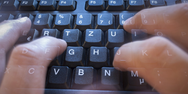 Finger in motion on tack sharp keyboard.