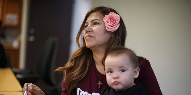 Mexican immigrant Maria Hernandez, 50, feeds her ten-month-old grandson Pablo at a Mother's Day celebration for immigrant mothers in Los Angeles, California, U.S., May 10, 2017. REUTERS/Lucy Nicholson
