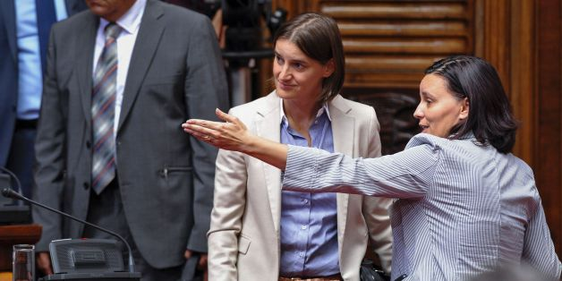Serbia's future Public Administration Minister Ana Brnabic (C) arrives to the Serbian Parliament on August 9, 2016 in Belgrade. Serbian Prime Minister Aleksandar Vucic announced a new cabinet line-up on August 8 that included the first openly gay ministerial candidate in the conservative Balkan country. Ana Brnabic, 40, is set to be appointed minister for state administration, pending parliamentary approval of the cabinet on August 9.  / AFP / ALEXA STANKOVIC        (Photo credit should read ALEXA STANKOVIC/AFP/Getty Images)